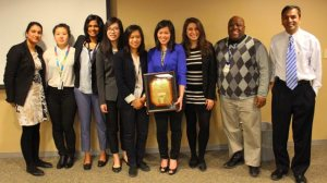 Image of winning team holding Dragons' Den plaque along with Dr. Atul Humar and Segun Famure